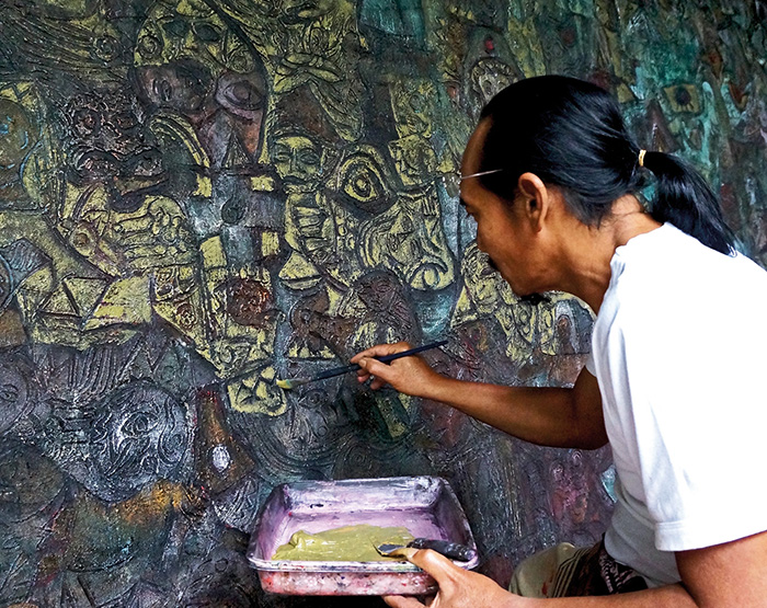 Celebrated Balinese painter I Made Djirna working in his home studio(thumb)