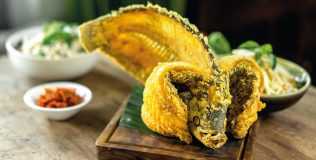Crispy whole fish with sambal mangga and kemangi