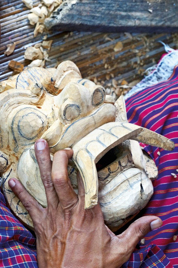 A Mas Wood Carver Crafting a Barong Mask