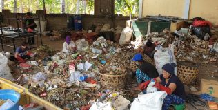 Sorting of organic, recyclable and non-recyclable waste by paid staff at TPST Bondalem